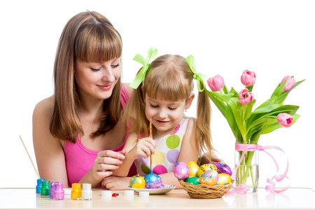 mother and baby kid painting easter eggs isolated