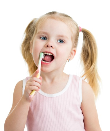 Photo pour cute child girl brushing teeth isolated on white background - image libre de droit