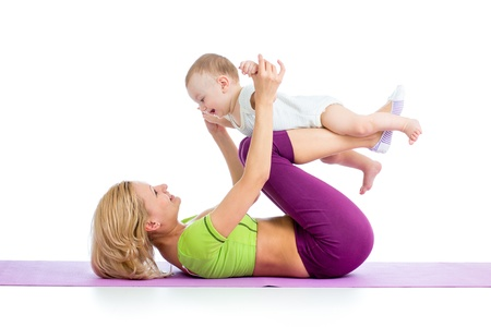Photo for mother with baby doing gymnastics and fitness exercises - Royalty Free Image