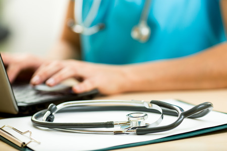 Foto de close up of female doctor working with laptop - Imagen libre de derechos