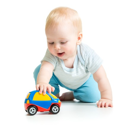 Photo pour baby boy toddler playing with toy car isolated - image libre de droit