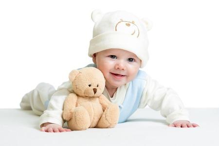 Photo pour baby boy weared funny hat with plush toy - image libre de droit