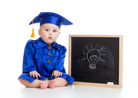 funny baby girl in academician clothes at chalkboard isolated