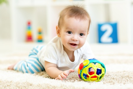 Photo pour baby boy playing with toys indoors at home - image libre de droit