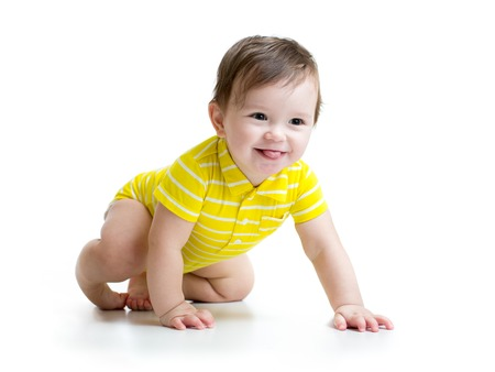 funny smiling baby boy crawling isolated on white