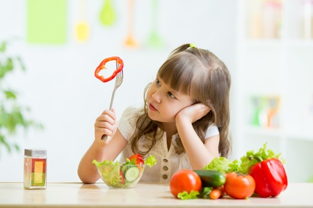 Photo pour pretty kid girl refusing to eat her dinner healthy vegetables - image libre de droit