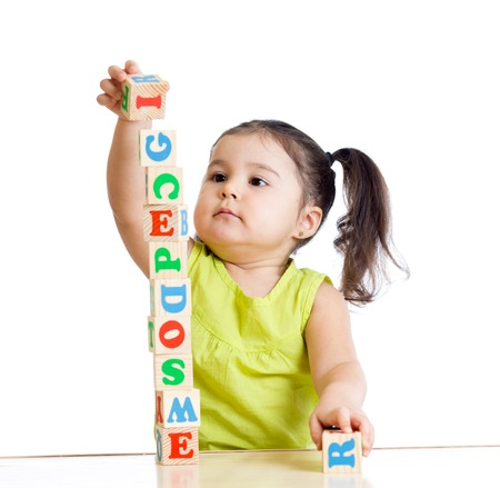 Photo pour child girl playing with block toys on white background - image libre de droit