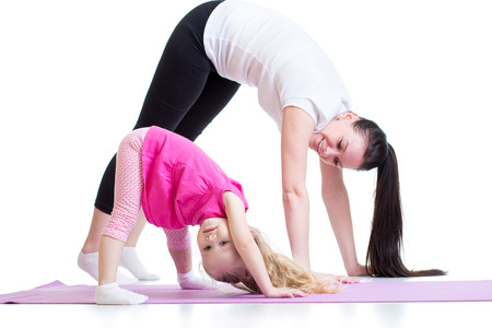 Mother and child daughter doing exercise at homeの写真素材