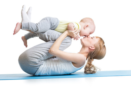 Foto de young mother does fitness exercises together with kid boy isolated - Imagen libre de derechos