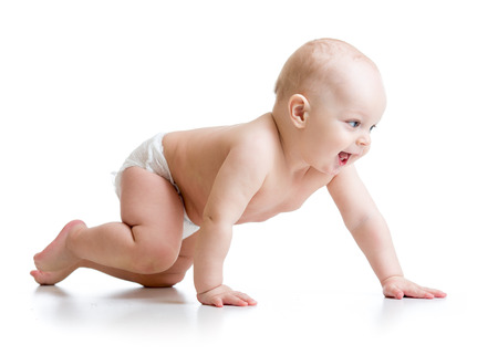 side view of crawling baby boy isolated