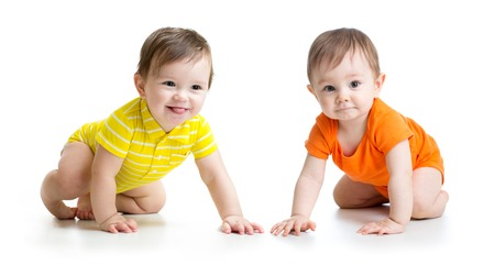Photo pour Two cute babies boys crawling on floor. Toddlers isolated on white background. - image libre de droit