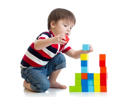 Photo pour kid child boy playing with color cubes toys on floor isolated - image libre de droit