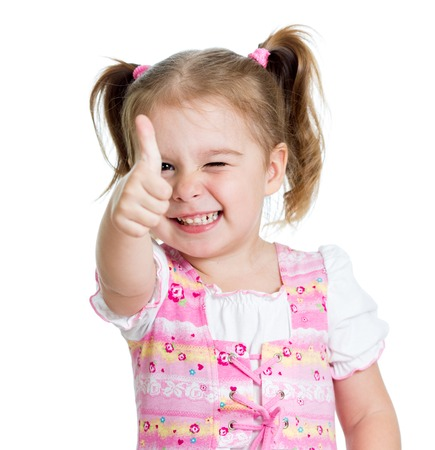 Foto de Child little girl giving you thumbs up - Imagen libre de derechos