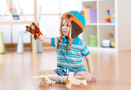 Photo for happy child toddler plays with toy airplane and dreaming of becoming a pilot - Royalty Free Image