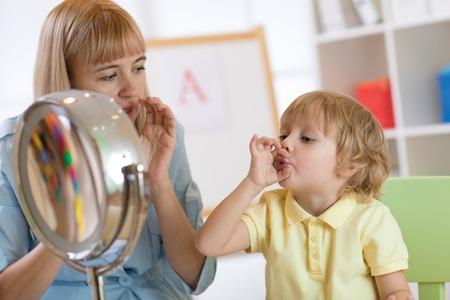 Photo pour Cute little boy at speech therapist office - image libre de droit