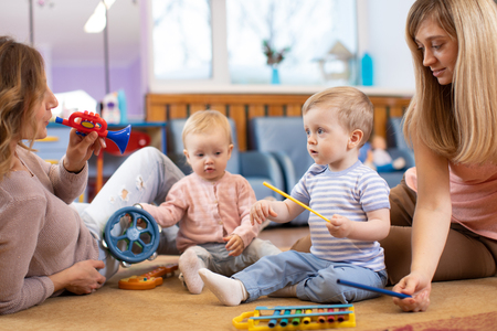 Photo pour Musical education for preschoolers. Parents playing musical toys with their children - image libre de droit
