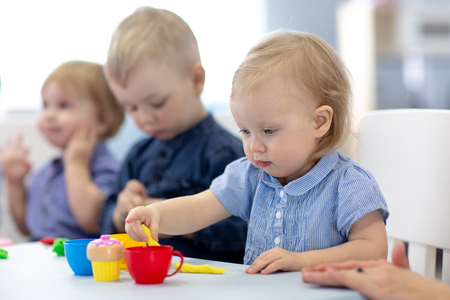 Photo for Group of babies kids engaged in handcrafts - Royalty Free Image