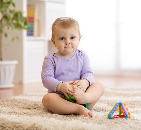 Foto für cute funny baby sitting on carpet at home - Lizenzfreies Bild