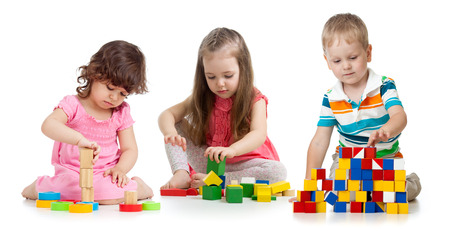 Photo pour kids toddlers playing wooden blocks toy isolated on white - image libre de droit