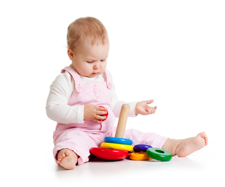 Photo pour Adorable baby playing enthusiastically woth educational toy. Small kid sits on floor, isolated on white - image libre de droit
