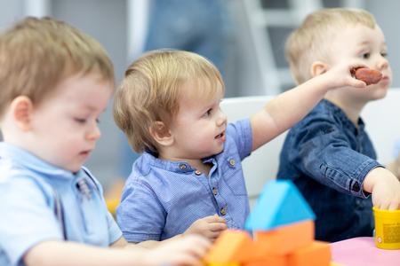 Photo pour Nursery kids on lesson in preschool - image libre de droit