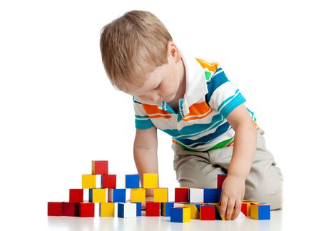 Photo for kid toddler playing wooden blocks toy isolated on white - Royalty Free Image