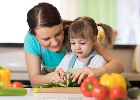 Photo pour Toddler girl cooking with her mother - image libre de droit