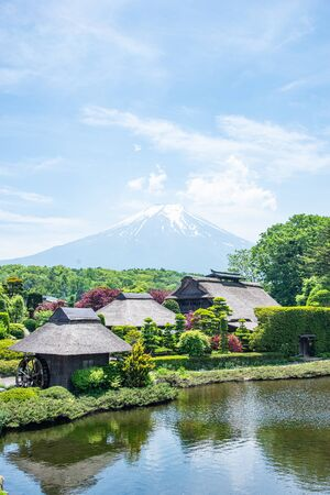 Photo for Beautiful Fuji mountain with cloud and blue sky  in the summer at Oshino Hakkai the old Japanese village, the famous landmark and attraction place of tourists who have a long holiday in Japan - Royalty Free Image