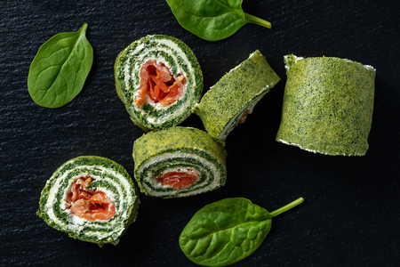 Spinach rolls with smoked salmon and cream cheese.