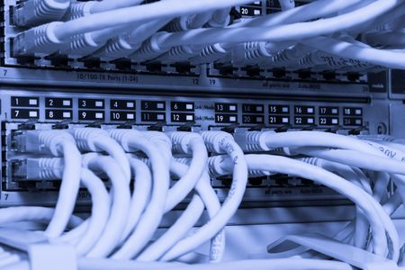 Toned image of network cables connected to switch
