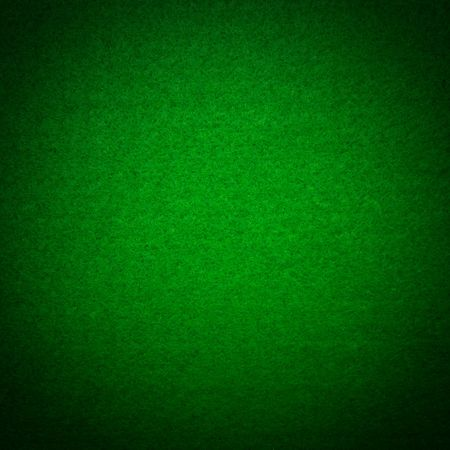 Close-up of green poker table felt background