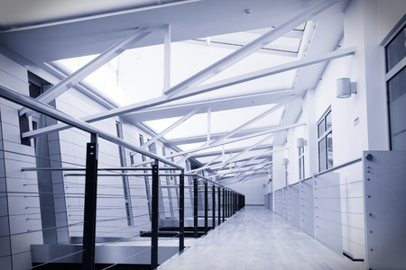 Toned image of empty corridor in modern office building