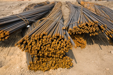 Lots of rusty metal rods on construction site