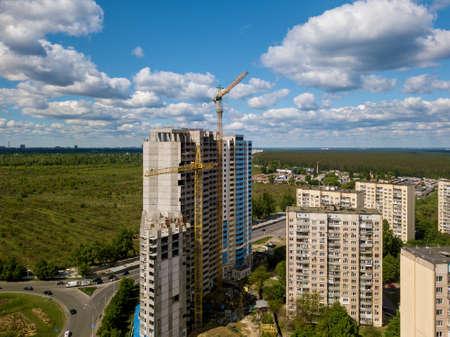 Photo pour Construction site with multi-storey buildings, tower cranes and construction equipment. construction of high-rise buildings - image libre de droit
