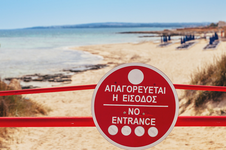 Photo for Sign No Entrance before the beach near of Ayia Napa and Cavo Greco, Cyprus island, Mediterranean Sea. - Royalty Free Image