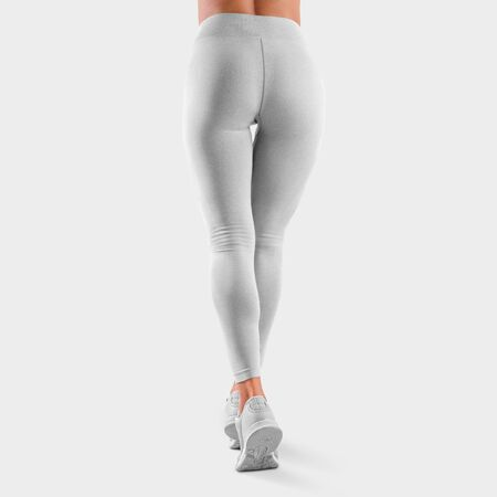 Photo pour Mockup of sports leggings on a fit girl standing on toes in sneakers, rear view, stretch fabric clothes for presentation of design and pattern. Template white women's pants isolated on background - image libre de droit