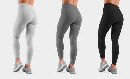 Photo pour Template sweatpants on a fit girl with bent leg, isolated on background, back view. Mockup of white, gray, black leggings on a model for design presentation. Set of women's clothing - image libre de droit