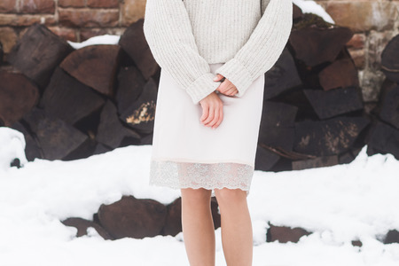 Photo pour Winter look, girl in warm woolen sweater and a skirt made of natural silk with lace - image libre de droit