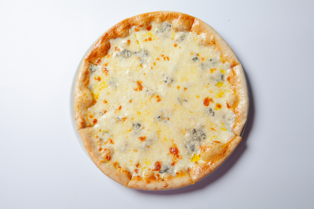 Italian delicious pizza with cheese on a white plate. White background