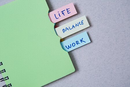 Photo pour Work life balance choice concept. Stickers with inscriptions in a notebook - image libre de droit