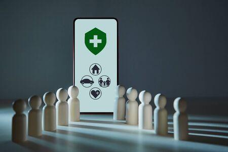 Photo pour Online life-assurance service. Health, accident insurance. Medicine and healthcare. Assurance signs on cellphone screen - image libre de droit