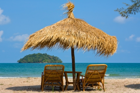 Photo for Sun loungers with an umbrella on the beach - Royalty Free Image