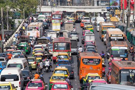 BANGKOK, THAILAND - JANUARY 22, 2015: Traffic moves slowly along a busy road in Bangkok, Thailand. Annually an estimated 150,000 new cars join the already heavily congested streets of Bangkok.