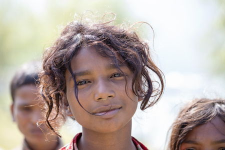 Photo for HIMALAYAS, ANNAPURNA REGION, NEPAL - OCTOBER 23, 2016 : Portrait nepalese children on the street in Himalayan village, Nepal - Royalty Free Image