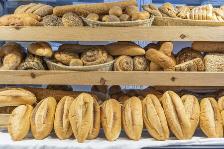 Foto für Modern bakery shop with assortment of bread on shelf, close up. Food concept. Variety of baked products at bread shop - Lizenzfreies Bild