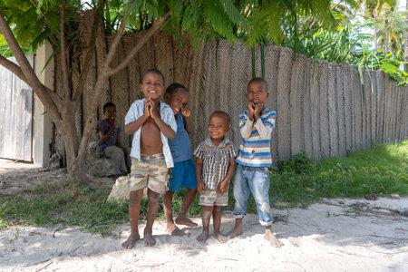 Photo for Zanzibar, Tanzania - january 04, 2020: Unknown african young happy boys on a street of Zanzibar island, Tanzania, East Africa, close up - Royalty Free Image