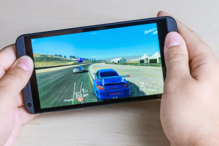 Moscow, Russia - August 26, 2014: Real Racing 3 game for android on your smartphone htc. Real Racing 3 game for mobile devices in the genre of road racing simulator.