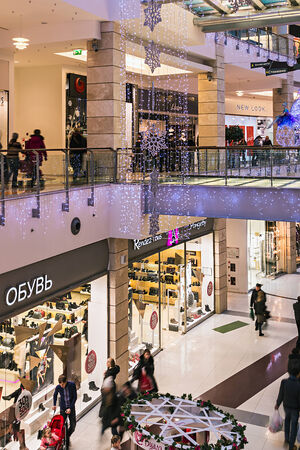 RUSSIA, MOSCOW - December 21, 2013: People enter to Metropolis shop before Christmas, Russia. Metropolis - the largest shopping and entertainment center of Moscow.