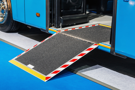 Photo pour platform for wheelchairs in the cabin of a modern and comfortable city bus or electric bus - image libre de droit