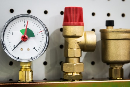 Photo for pressure gauge, fittings and valve, pipes and adapters. Plumbing fixtures and piping parts - Royalty Free Image